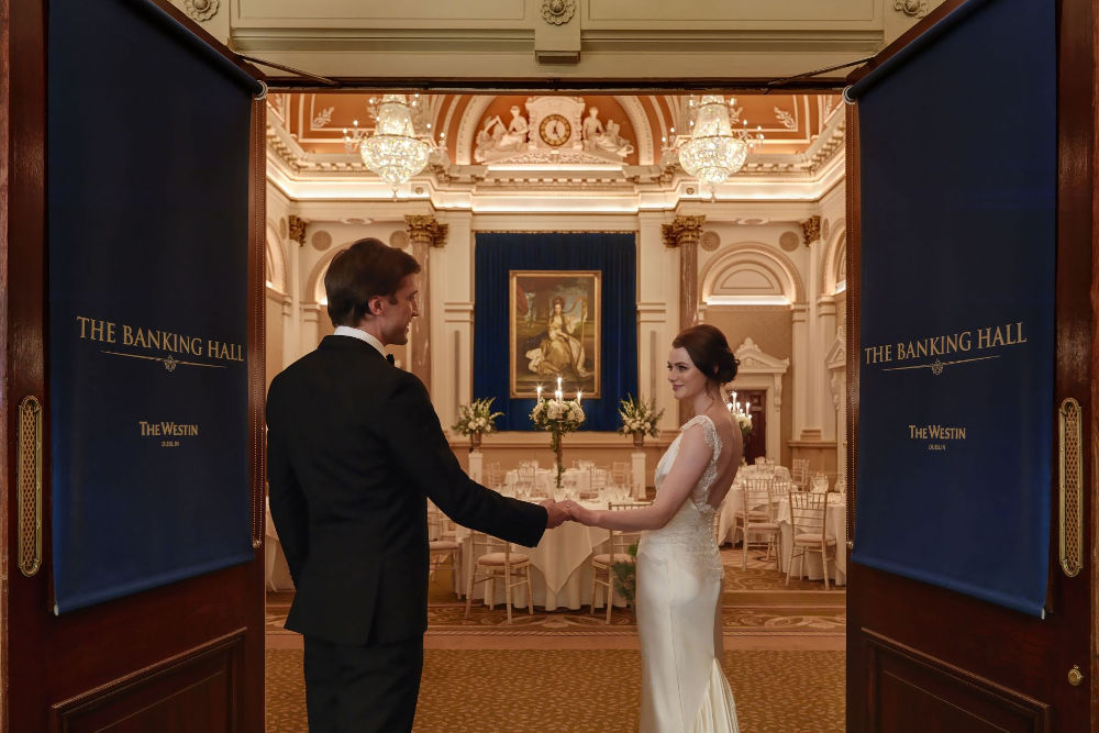 Couple-at-The-Banking-Hall-main-doors