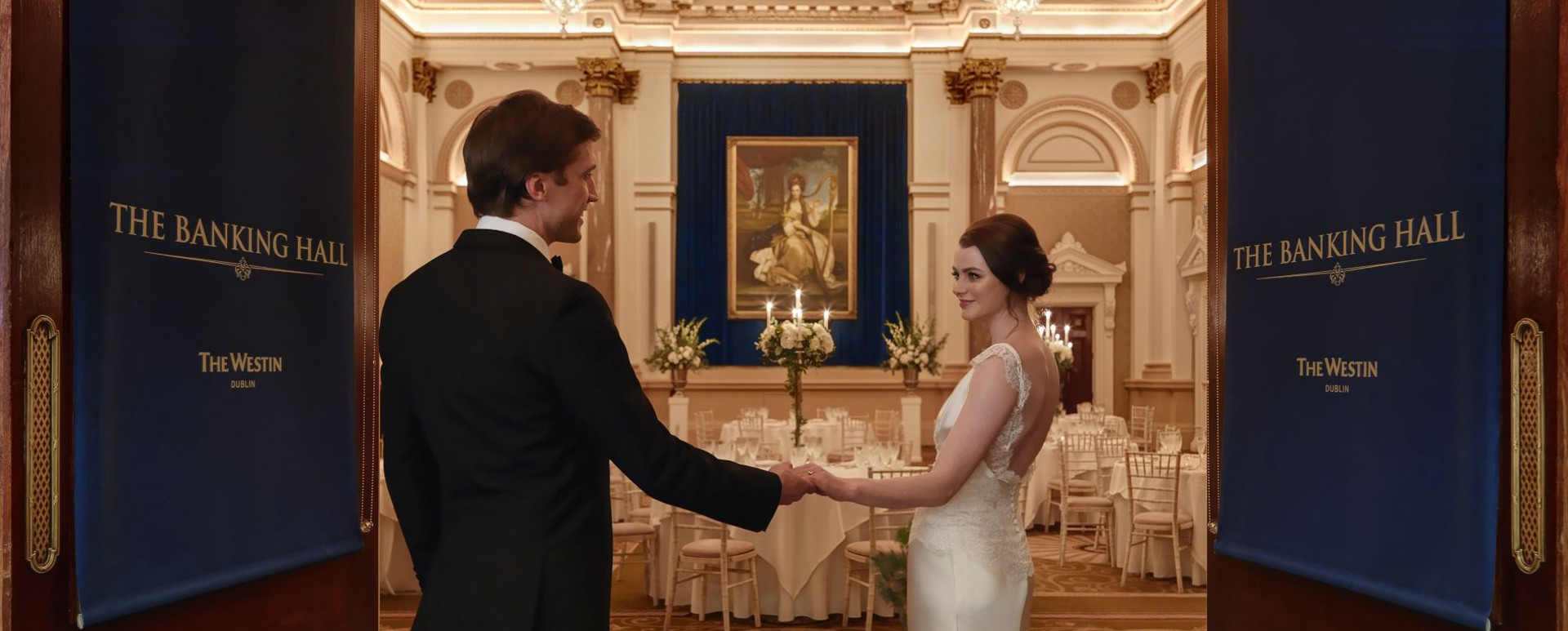 Wedding Couple-at-The-Banking-Hall-main-doors