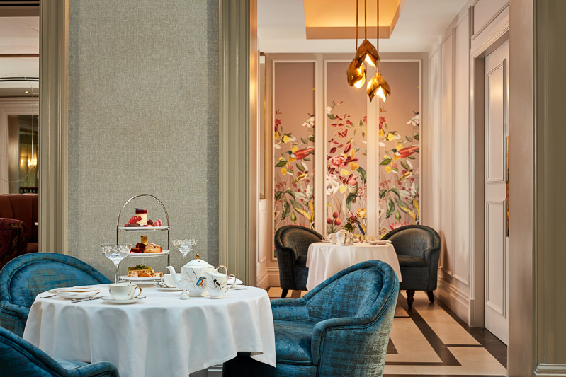 atrium lounge afternoon tea with floral wall backdrop