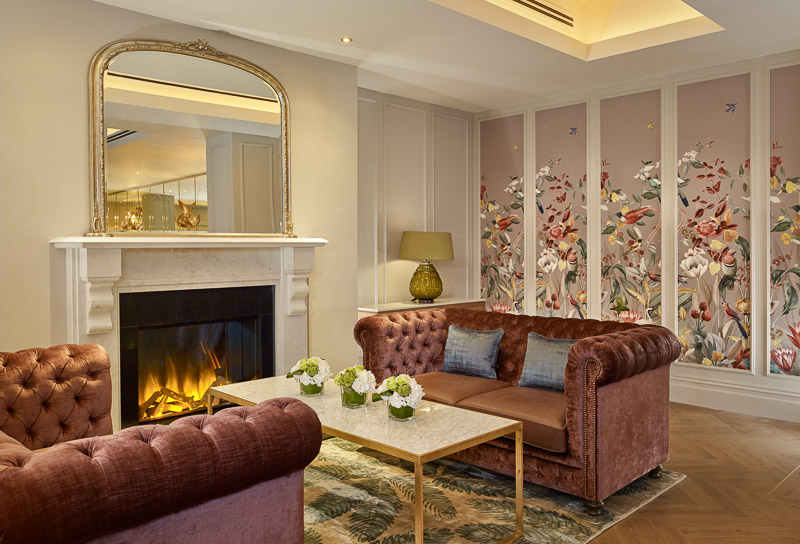 seating area by the fireplace at atrium lounge