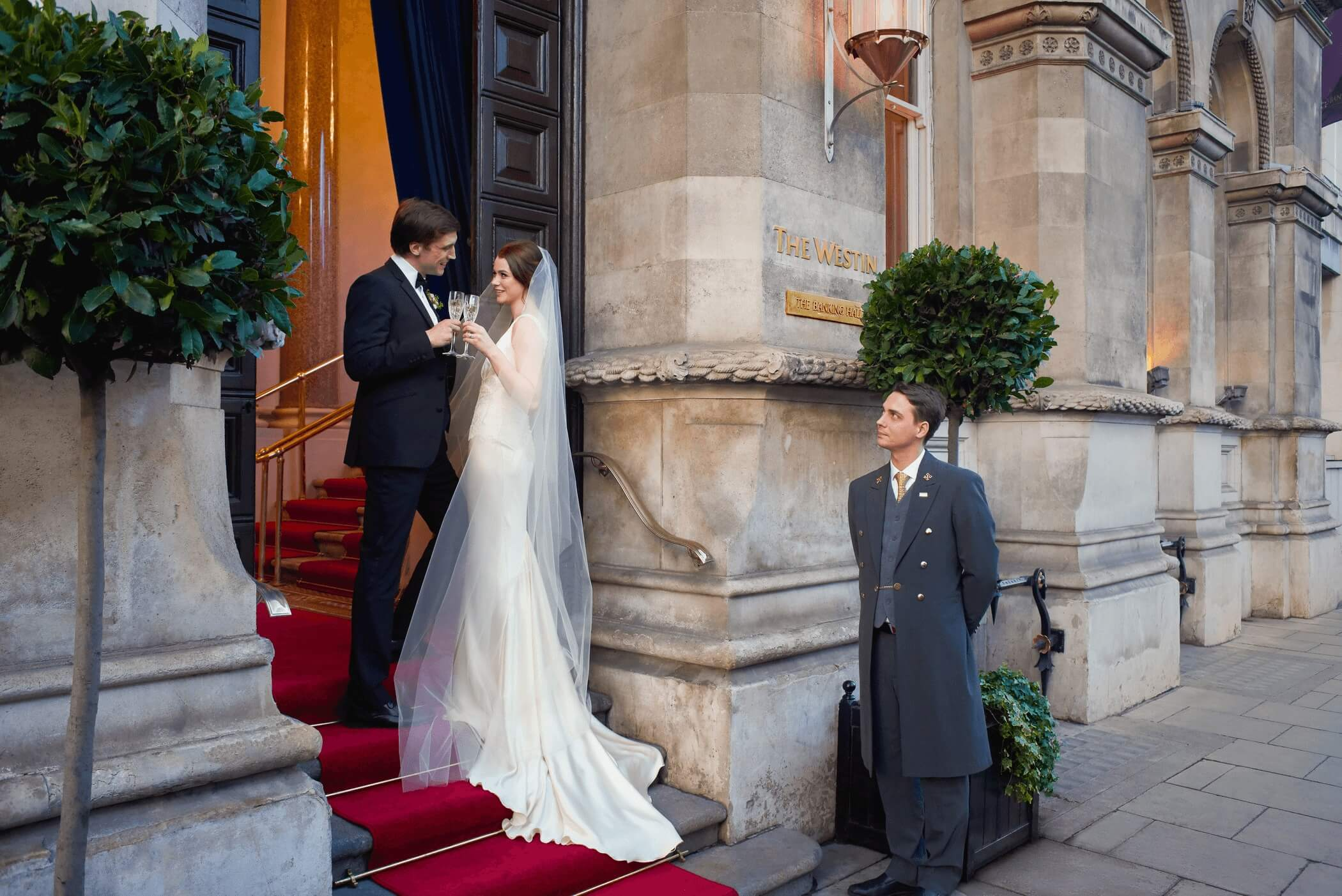 wedding couple at the banking hall entrance on college green