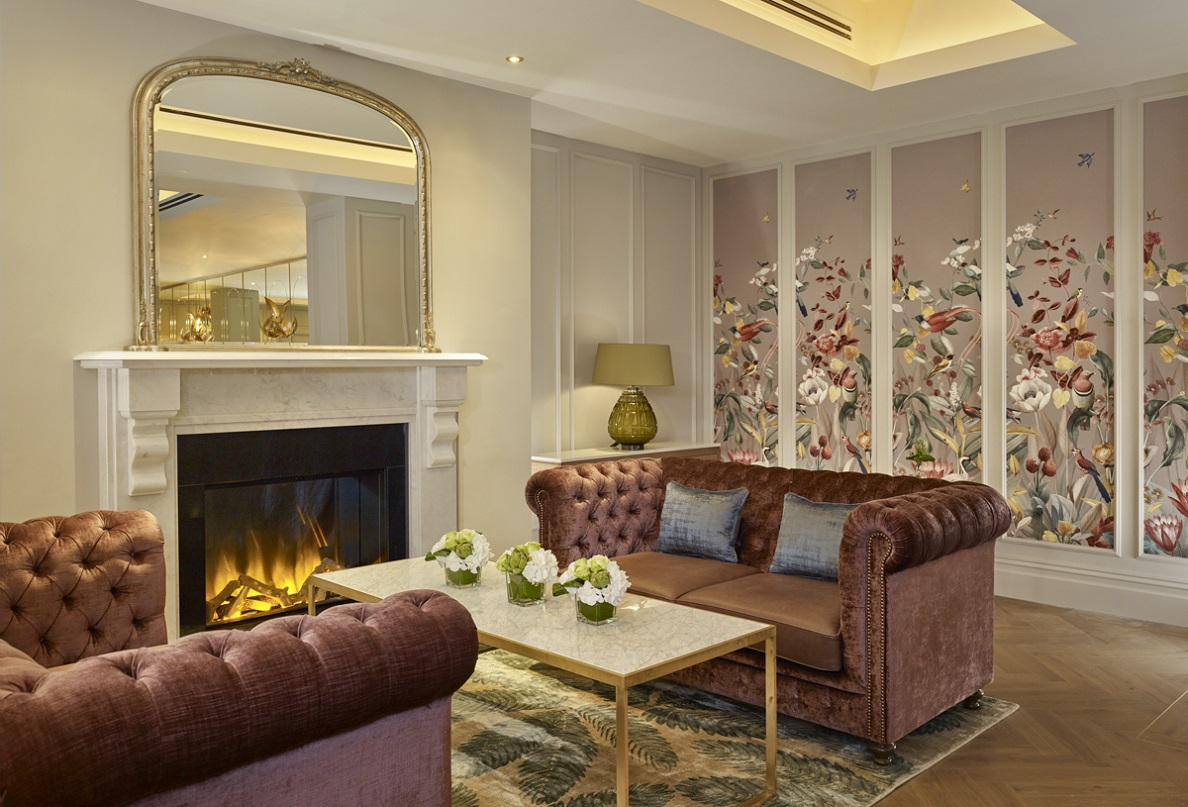 seating area by the fireplace at the atrium lounge